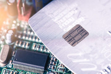the abstract image of the credit card placed on the computer's motherboard. the concept of e-commerce, electronic, payment, financial and internet of things