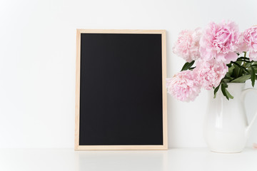 White portrait frame mock up with a pink peonies beside the frame, overlay your quote, promotion, headline, or design, great for small businesses, lifestyle bloggers and social media campaigns