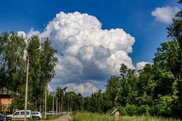 A very large cloud in the blue sky