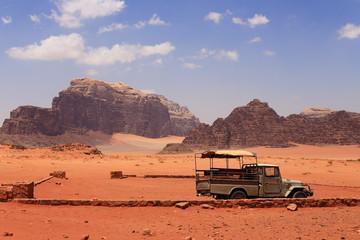 Anonymous car in the sand of Wadi Rum desert, Jordan.