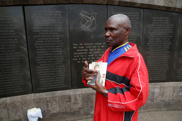 Ali Mwadama, a survivor of the 1998 U.S. Embassy bombing, poses for a photo during an interview for Reuters at the August 7th memorial park in Nairobi