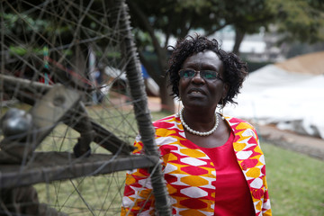 Julie Ogoye, a survivor of the 1998 U.S. Embassy bombing, poses for a photo during an interview for Reuters at the August 7th memorial park in Nairobi