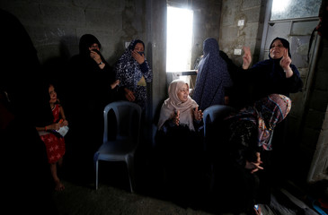 Relatives of Palestinian Hamas militant Ahmed Murjan who was killed in Israeli tank shelling, mourn during his funeral in Jabaliya, northern Gaza Strip