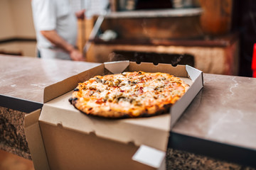 Delicious pizza in a box for take away.