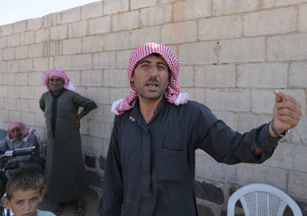 Mohamad al-Youssef, 33, gestures as he speaks in Idlib
