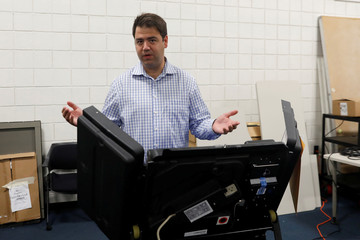 Democratic candidate Danny O'Connor, in Ohio's 12th congressional district, gestures after casting his vote duringTuesday's special election in Columbus, Ohio
