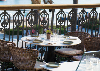 Served table for four persons in restaurant at summer.
