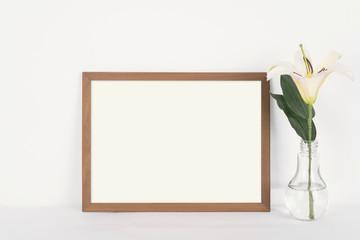 Blank Photo Frame Decoration on Wooden for Design Mockup Template.