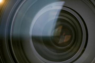 closeup camera shutter lens technology background.