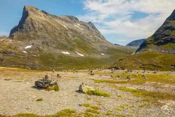 Stone pyramids on mountain background near Trollstigen in Norway