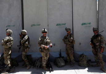 U.S. troops wait at their base to fly to a training and advisory mission at an Afghan National Army (ANA) Base in Logar province, Afghanistan