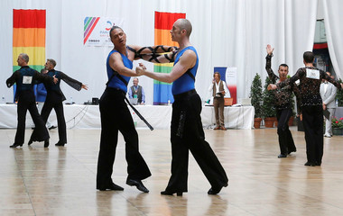 Same sex dance duos perform during the Dancesport competition in the Gay Games at the Japy Gymnasium in Paris