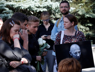 People mourn during a funeral ceremony for Rastorguyev, one of three Russian TV journalists killed in volatile Central African Republic, in Moscow