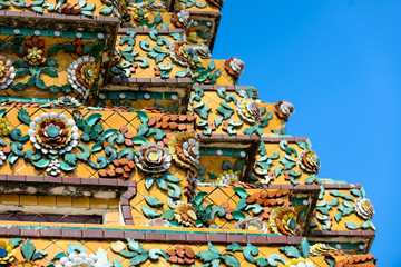 Close up beauitful mosaic tiles of large stupas in Wat Pho or Wat Phra Chetuphon Vimolmangklararm Rajwaramahaviharn is one of Bangkok's oldest temples, THAILAND