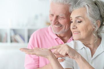 Portrait of senior couple posing at home