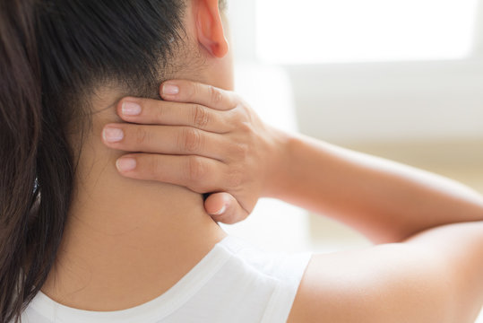 Closeup woman neck and shoulder pain and injury. Health care and medical concept.