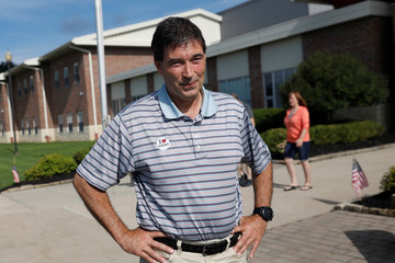 Republican candidate Balderson waits to greet voters in Newark, Ohio