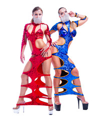 striptease dancers wearing extravagant costumes