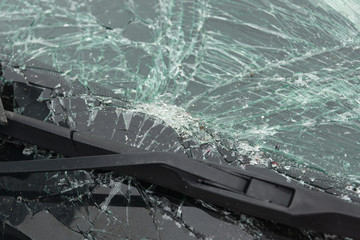 Smashed windscreen or windshield on a car in close up ideal for vehicle insurance claim or vandalism concepts