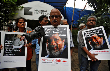 Journalists protest against the arrest of Bangladeshi photojournalist Shahidul Alam and the recent attack on Indian photojournalist Pravin Indrekar, at the Press Club in Mumbai