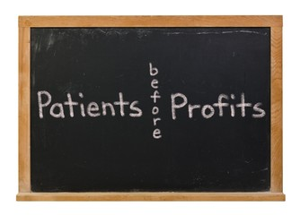 Patients before profits written in white chalk on a black chalkboard isolated on white