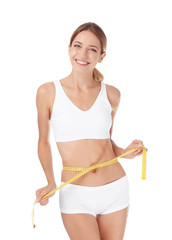 Happy slim woman in underwear with measuring tape on white background. Positive weight loss diet results