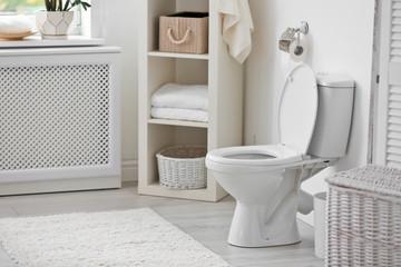 Toilet bowl in modern bathroom interior