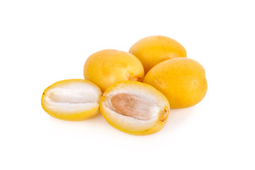 whole and half cut fresh yellow dates on white background