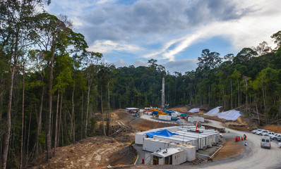 Drilling land rig in oil and gas exploration; location Borneo rain forest