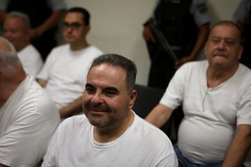 El Salvador's former president Elias Antonio Saca waits for his hearing on corruption charges in San Salvador