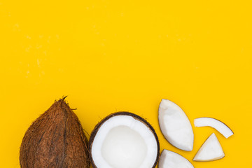 Tropical summer coconut on a yellow background.