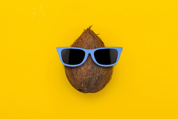 Tropical summer coconut with sunglasses