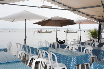 restaurant terrace at an oyster farmer at the foot of the ocean to eat oysters