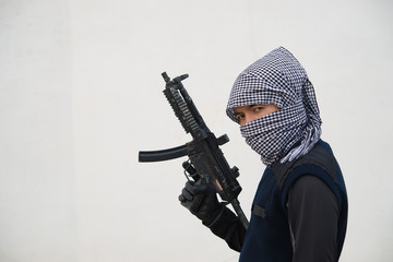 Close up terrorist with gun on white background,Thailand people,A bad guy,He is no good man