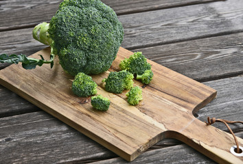 Powerful antioxidant of broccoli stands out as the most concentrated source of vitamin C..Broccoli on wooden floor.