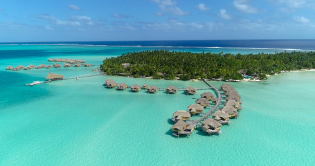 Water bungalows resort at islands, french polynesia in aerial view