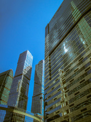 Modern office building, bright blue color photo