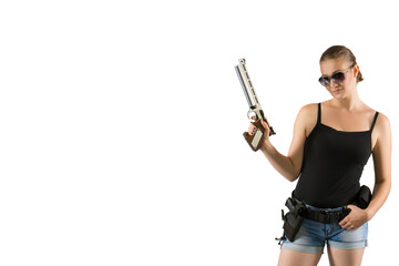 Young beautiful woman holding a sport gun on white background