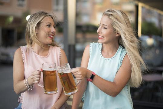 Blonde sister woman drinking beer in bar