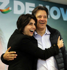Fernando Haddad, former Sao Paulo mayor and member of Workers' Party (PT), and Manuela D'avila of the PCdoB pose before a media conference in Sao Paulo