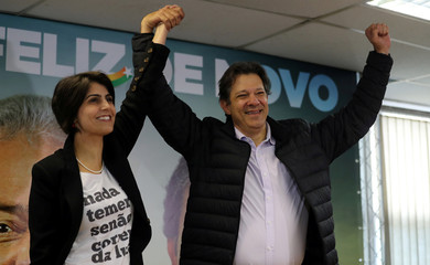 Fernando Haddad, former Sao Paulo mayor and member of Workers' Party (PT), and Manuela D'avila of the Communist Party of Brazil (PCdoB) pose before a media conference in Sao Paulo