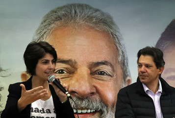 Fernando Haddad, former Sao Paulo mayor and member of Workers' Party (PT), and Manuela D'avila of the Communist Party of Brazil (PCdoB) attend a media conference in Sao Paulo