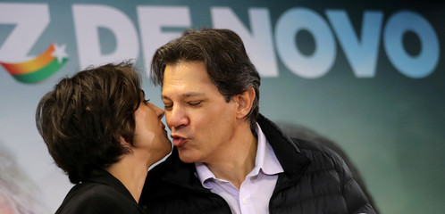 Fernando Haddad, former Sao Paulo mayor and member of Workers' Party (PT), kisses Manuela D'avila of the Communist Party of Brazil (PCdoB) before a media conference in Sao Paulo