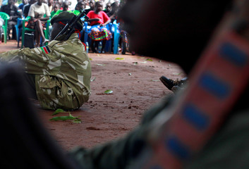 A former child soldier holds a gun as they participate in a child soldiers' release ceremony, outside Yambio