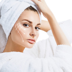 Woman in bathrobe with lifting lines on face.