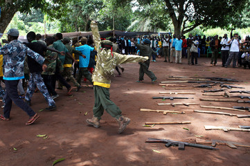 Former child soldiers march at a parade as they attend a child soldiers' release ceremony, outside Yambio