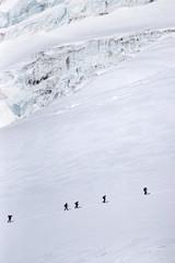 A group of climbers crossing Gara-Bashi glacier on Elbrus slope.