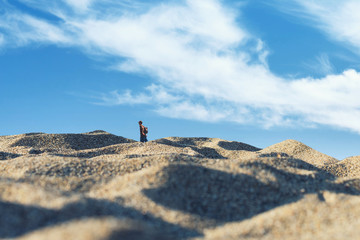 Minimalist photography of a man in the desert. Concept