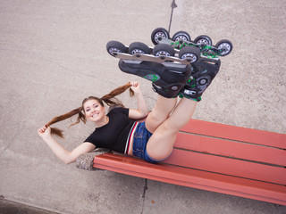 Crazy woman on bench wearing roller skates
