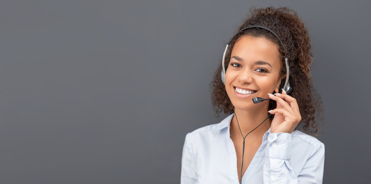 Call center employee isolated on a gray background.